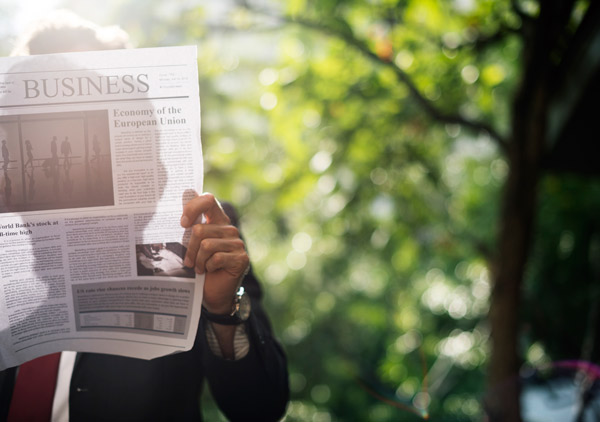 man reading a business newspaper outdoors. how to increase your productivity level with lifestyle changes and habits. future access st catharines