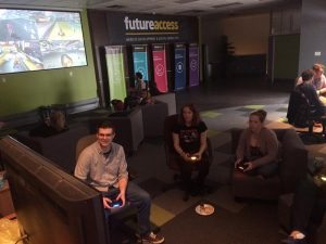 Future Access Employees playing video games and board games during scheduled team building time on game day friday