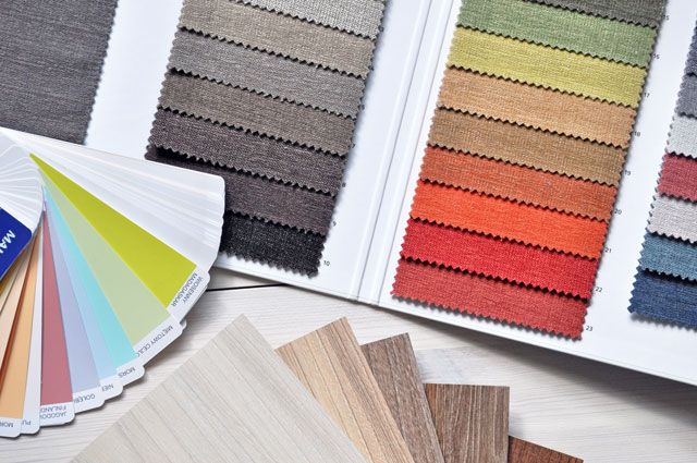 paint colour samples laid out with hardwood samples. how colour influences marketing. future access in st. catharines
