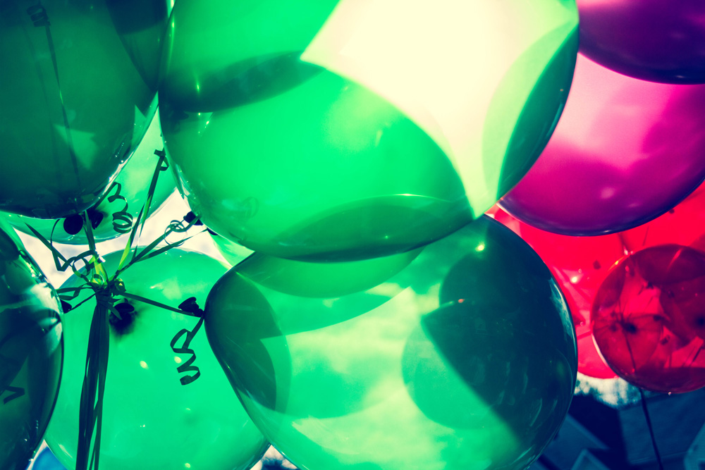 green and red balloons for the christmas season. how to celebrate your staff this holiday season. off site party ideas.