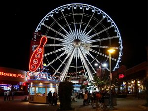 niagara falls' clifton hill at night with the sky wheel. where to host a work christmas party in the niagara region.