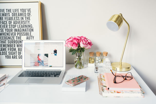 e-commerce website on mac laptop with cute desk accessories on the desk. how seo can help your e-commerce website. future access. niagara region