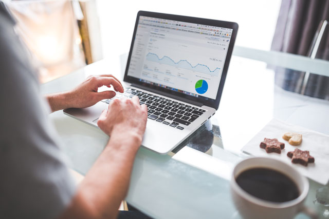 man using google analytics on laptop to see website traffic and data. future access shares why seo is important for your business online. st. catharines