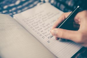 writing a checklist in a notebook can help inspire your work and office life. niagara based web agency, future access shares how you can stay inspired at the office.