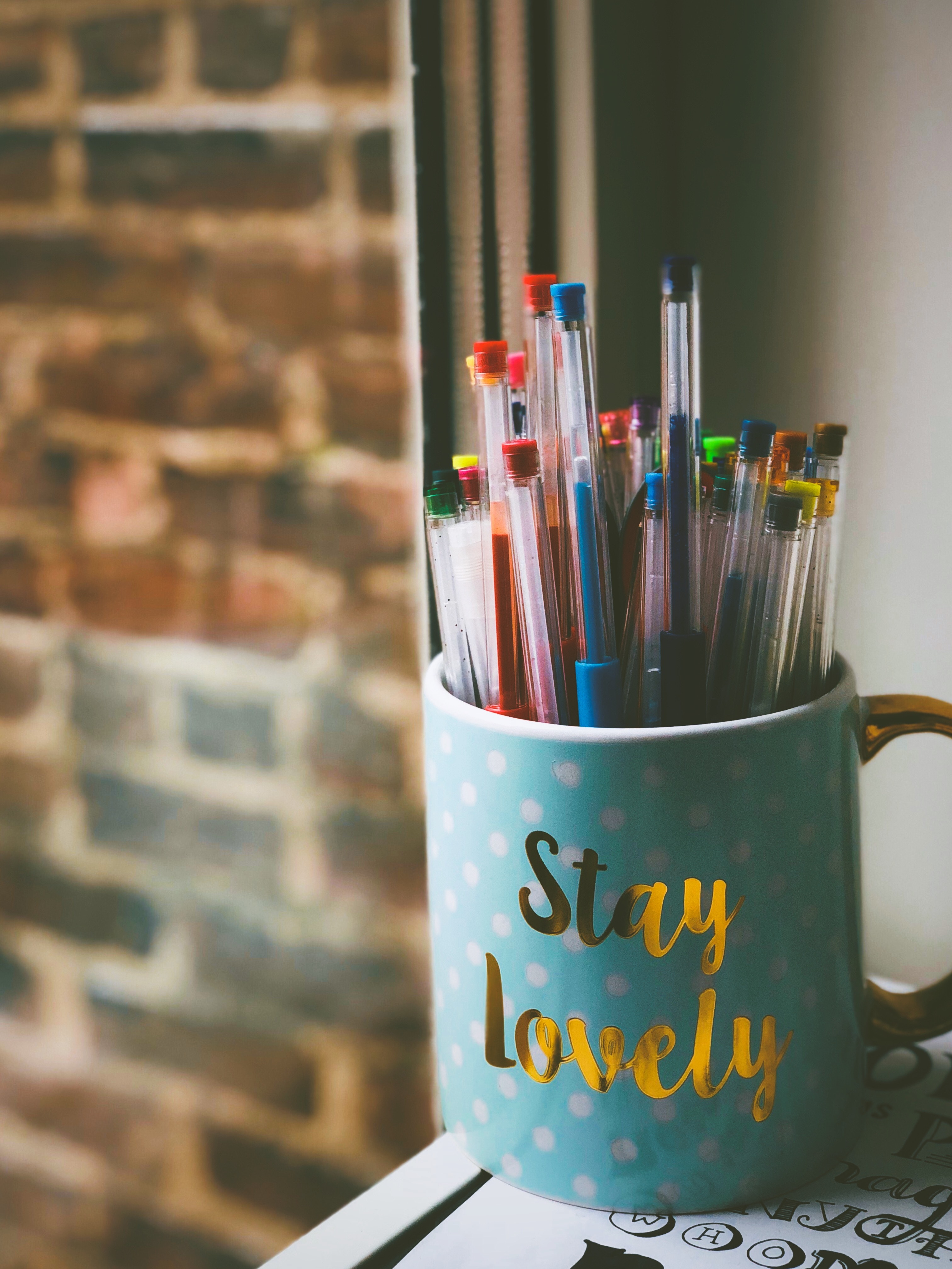 blue mug used as a colourful pen holder. 3 habits you can do at the office to stay productive all day. niagara region based app and web development agency shares how to stay inspired at the office.