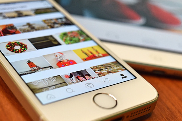 iphone with instagram app open, displaying photos. should you market your business on instagram? experienced digital marketers at future access share their thoughts in marketing on instagram. niagara