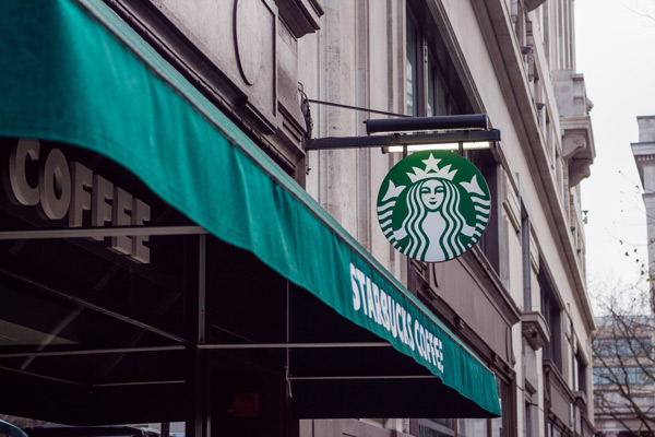 starbucks store front with starbucks signage and logo. the importance of logos with niagara born digital marketing agency, future access.