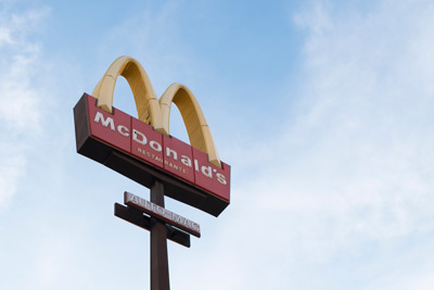 mcdonald's signage and logo with blue skies in the background
