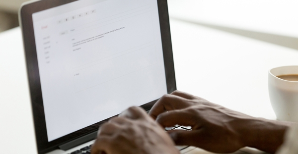 man-typing-out-an-email-on-laptop | Future Access Inc.